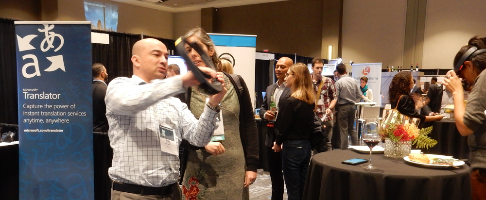 A vendor at MW17 fits a conference goer with a virtual reality headset.